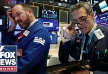 White House optimistic despite wild stock market swings